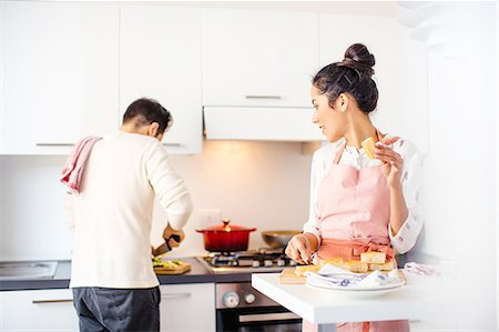 Young couple in kitchen preparing food Stock Photo - Premium Royalty-Free, Code: 649-08565986