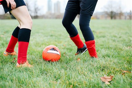 female 16 year old feet - Legs of female soccer players practicing in park Stock Photo - Premium Royalty-Free, Code: 649-08566007