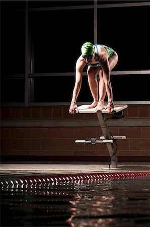 platform - Swimmer poised to dive into pool Stock Photo - Premium Royalty-Free, Code: 649-08560912