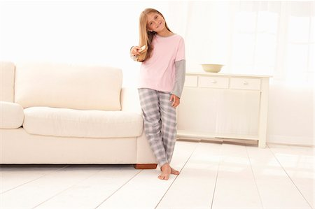 Girl in pajamas leaning on couch Stock Photo - Premium Royalty-Free, Code: 649-08561273