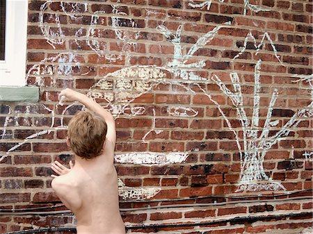 Boy chalk drawing on brick wall Stock Photo - Premium Royalty-Free, Code: 649-08563351