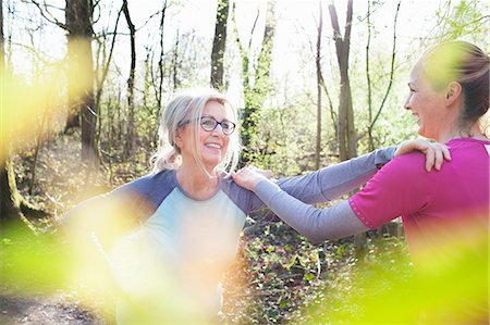 fitness   mature woman - Women in forest, hand on each others shoulders stretching Stock Photo - Premium Royalty-Free, Code: 649-08576851