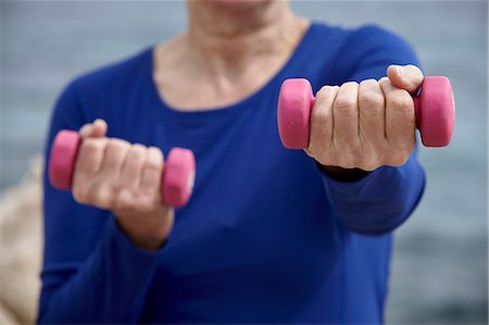 Mature woman outdoors, exercising with hand weights Stock Photo - Premium Royalty-Free, Code: 649-08577017