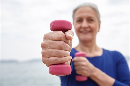 fitness   mature woman - Mature woman exercising with hand weights Stock Photo - Premium Royalty-Free, Code: 649-08577013