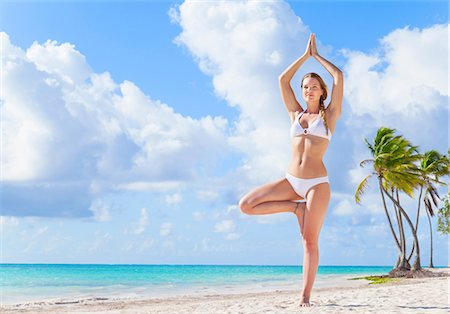practise - Young woman wearing bikini practising yoga tree pose on beach, Dominican Republic, The Caribbean Stock Photo - Premium Royalty-Free, Code: 649-08577326