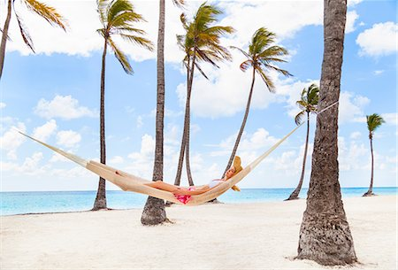 palm - Young woman reclining in palm tree hammock at beach, Dominican Republic, The Caribbean Stock Photo - Premium Royalty-Free, Code: 649-08577330