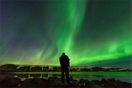 person - Man photographing Northern Lights, Kleifarvatn, Iceland Stock Photo - Premium Royalty-Free, Code: 649-08577480