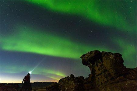 person - Man watching Northern Lights, Krysuvik, Iceland, Iceland Stock Photo - Premium Royalty-Free, Code: 649-08577481