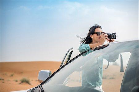 Female tourist photographing from off road vehicle in desert, Dubai, United Arab Emirates Stock Photo - Premium Royalty-Free, Code: 649-08577588
