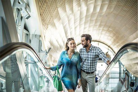 dress - Tourist couple moving up shopping mall escalator, Dubai, United Arab Emirates Stock Photo - Premium Royalty-Free, Code: 649-08577613
