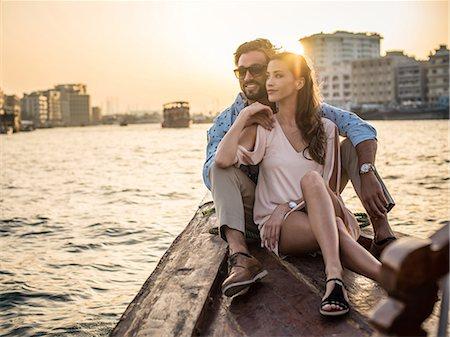 Romantic couple sitting on boat at Dubai marina, United Arab Emirates Stock Photo - Premium Royalty-Free, Code: 649-08577650