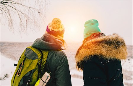 Rear view of couple wearing knit hats looking away at view Stock Photo - Premium Royalty-Free, Code: 649-08578135