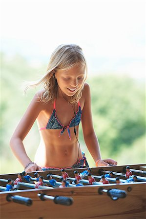 Girl in garden playing table football, Buonconvento, Tuscany, Italy Stock Photo - Premium Royalty-Free, Code: 649-08578165
