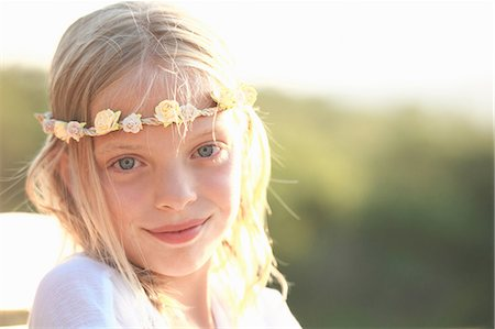 pretty - Portrait of blond girl wearing flower headband, Buonconvento, Tuscany, Italy Stock Photo - Premium Royalty-Free, Code: 649-08578176