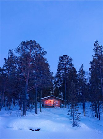 Cabin in the snow, Lemmenjoki National Park, Finland. Stock Photo - Premium Royalty-Free, Code: 649-08632860