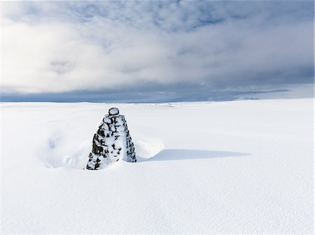 Stone mound in snow covered landscape, Myvatn, Iceland Stock Photo - Premium Royalty-Free, Code: 649-08633093