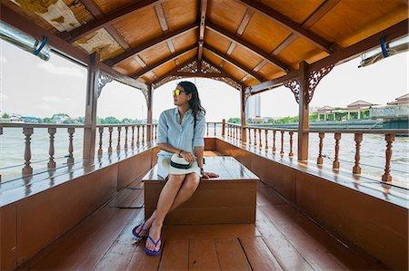 Woman on boat looking away, Chao Phraya River, Bangkok, Thailand Stock Photo - Premium Royalty-Free, Code: 649-08660691