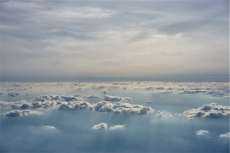 dreamy - Aerial view above and below clouds Stock Photo - Premium Royalty-Free, Code: 649-08660925