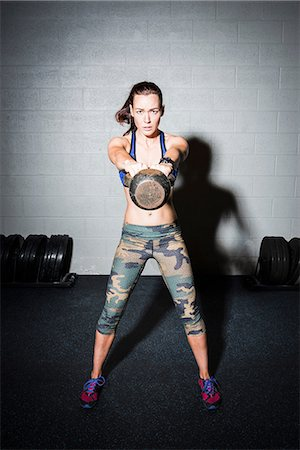 sports - Portrait of young woman training, weight lifting dumbbell in gym Stock Photo - Premium Royalty-Free, Code: 649-08660958