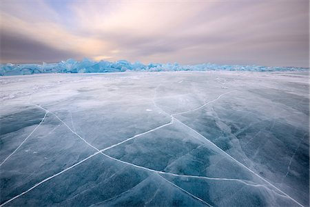 Cracked patterned ice, Baikal Lake, Olkhon Island, Siberia, Russia Stock Photo - Premium Royalty-Free, Code: 649-08661135