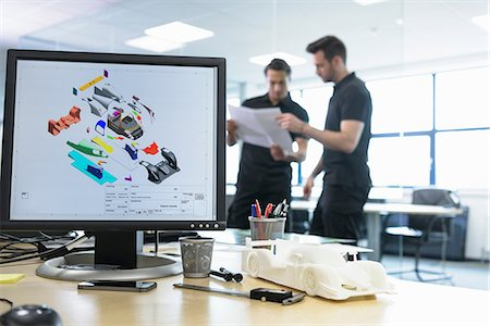 designer - Engineers work with CAD design imagery in racing car factory Stock Photo - Premium Royalty-Free, Code: 649-08661478