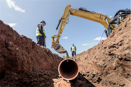 pipework - Builders laying pipework on housing building site Stock Photo - Premium Royalty-Free, Code: 649-08661672