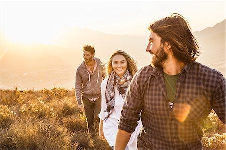 friluftsliv - Friends rambling on grassland smiling Stock Photo - Premium Royalty-Free, Code: 649-08662137
