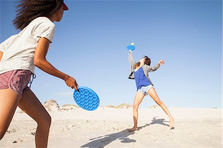 female only - Women on beach playing tennis Stock Photo - Premium Royalty-Free, Code: 649-08662147