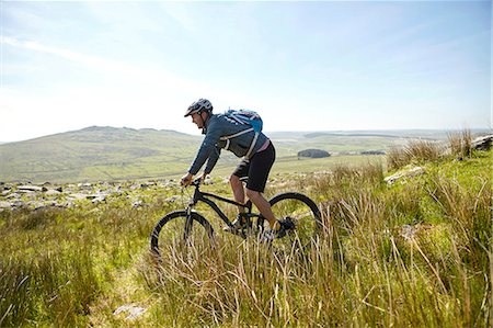 sports - Cyclist cycling on hillside Stock Photo - Premium Royalty-Free, Code: 649-08662224
