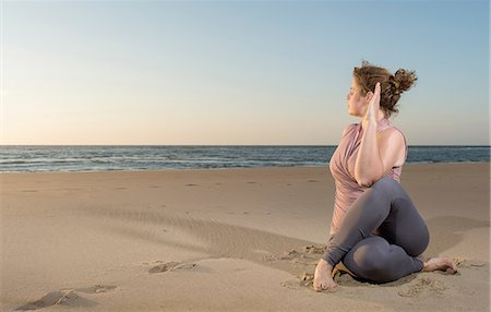 fat lady sitting - Mature woman practising yoga on a beach at sunset, sitting cross legged Stock Photo - Premium Royalty-Free, Code: 649-08702380