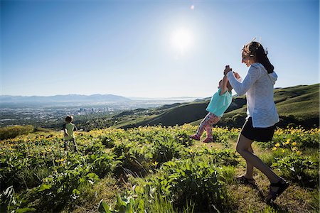 friluftsliv - Mother playing with children in filed, hiking the Bonneville Shoreline Trail in the Wasatch Foothills above Salt Lake City, Utah Stock Photo - Premium Royalty-Free, Code: 649-08714798