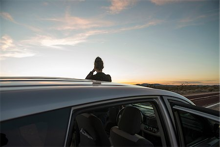 Rear view of silhouetted woman watching sunset, Mojave Desert, California, USA Stock Photo - Premium Royalty-Free, Code: 649-08714963