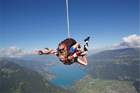 Tandem sky divers free falling as parachute released, Interlaken, Berne, Switzerland Stock Photo - Premium Royalty-Free, Code: 649-08715054