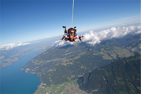 Tandem sky divers free falling as parachute released, Interlaken, Berne, Switzerland Stock Photo - Premium Royalty-Free, Code: 649-08715061