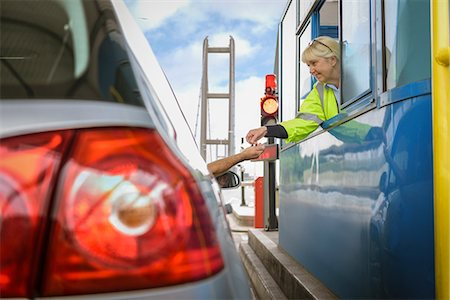 female rear end - Driver in car paying at toll booth at bridge Stock Photo - Premium Royalty-Free, Code: 649-08744802