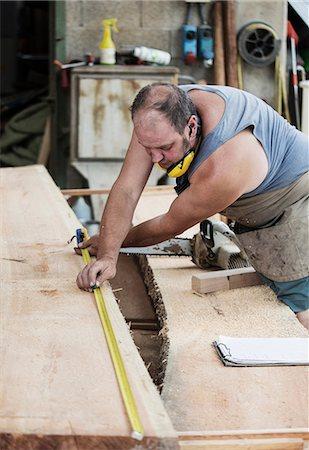 Carpenter working in workshop Stock Photo - Premium Royalty-Free, Code: 649-08744878