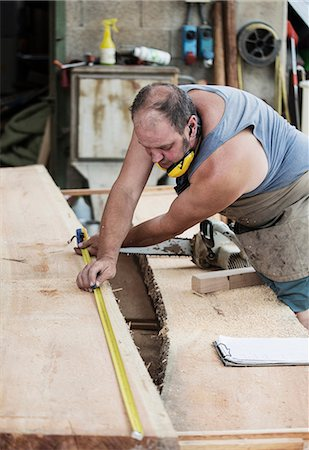 Carpenter working in workshop Stock Photo - Premium Royalty-Free, Code: 649-08744878