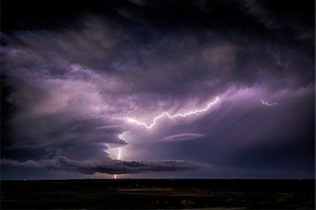 storm lightning - Lightning sparks from a spinning supercell thunderstorm at night near Leoti, Kansas Stock Photo - Premium Royalty-Free, Code: 649-08745101