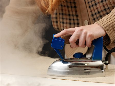 Cropped shot of young female designer steam ironing fabric Stock Photo - Premium Royalty-Free, Code: 649-08745563