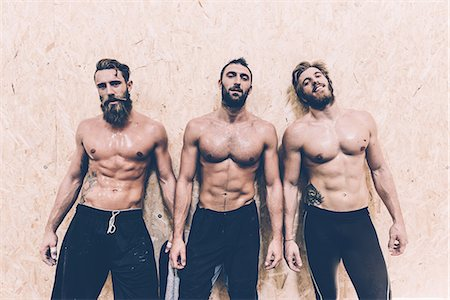 Portrait of three macho male cross trainers in gym Stock Photo - Premium Royalty-Free, Code: 649-08766485