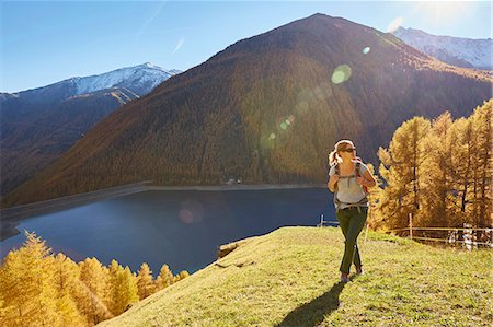 Woman hiking, looking at view, Schnalstal, South Tyrol, Italy Stock Photo - Premium Royalty-Free, Code: 649-08840525