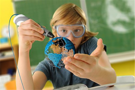 pre-teen boy models - Boy with digital pen and 3D model of globe in classroom Stock Photo - Premium Royalty-Free, Code: 649-08840767