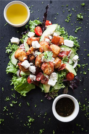 salad - Overhead view of meat and feta salad with dipping sauces on slate Stock Photo - Premium Royalty-Free, Code: 649-08859791