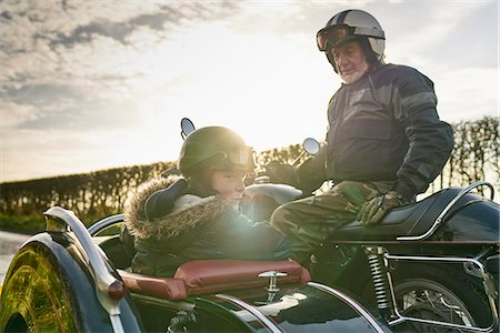 stain (dirty) - Senior man and grandson looking back from motorcycle and sidecar Stock Photo - Premium Royalty-Free, Code: 649-08894171