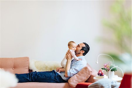 Father kissing baby girl Stock Photo - Premium Royalty-Free, Code: 649-08924608