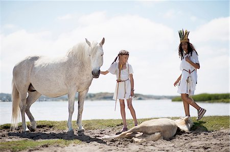 Girls with horses on sandy beach Stock Photo - Premium Royalty-Free, Code: 649-09003872