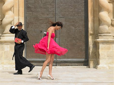 Priest passing woman whose skirt is blowing up in the wind, Alicante, Spain, Stock Photo - Premium Royalty-Free, Code: 649-01556999