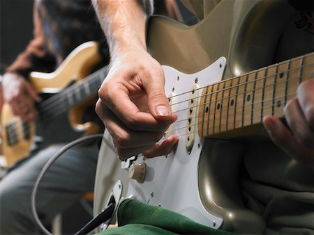 Two electric guitar players close up on hands. Stock Photo - Premium Royalty-Free, Code: 649-01608931