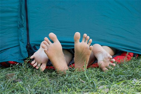 doing sex - Two people's feet sticking out of tent door. Stock Photo - Premium Royalty-Free, Code: 649-01696232