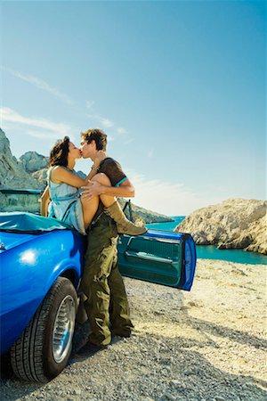 people having sex - Man kissing woman woman sitting on car. Stock Photo - Premium Royalty-Free, Code: 649-01753857